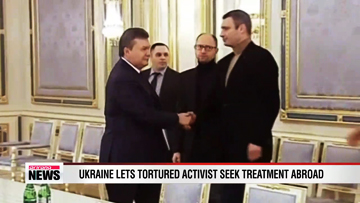 Ukraine frees tortured activist as president returns to work