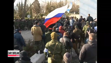 Russian forces storm Ukrainian base in Crimea