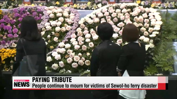People continue to mourn for victims of ferry disaster