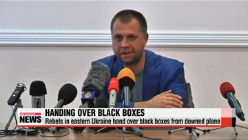 Rebels in eastern Ukraine hand over black boxes to Malaysian investigators