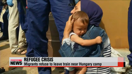 Refugee crisis continues in Europe as trains are stopped in Hungary