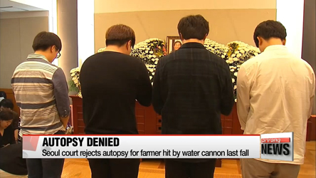 Seoul court rejects autopsy for farmer hit by water cannon last fall