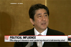 Japanese PM facing political scandal over school donation claim