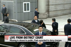 Ex-President Park attends arrest warrant hearing