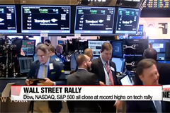 Wall Street share indexes close at record high on strong corporate earnings