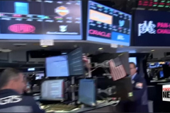 Dow Jones industrial average closes above 22,000 for first time