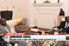 Mugabe seen in talks with military amid apparent coup