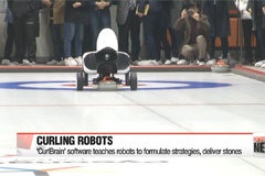 AI robots face human opponents in curling match