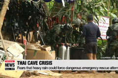 Football coach who took boys down flooded cave complex in Thailand says sorry to parents