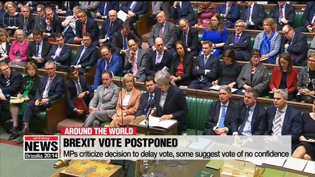 Facing almost certain defeat, UK PM May delays vote on Brexit plan