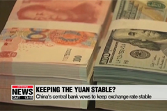 China's central bank vows to keep exchange rate stable