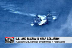 U.S. and Russia trade blame over warships' near collision