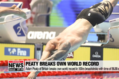 Adam Peaty of Britain breaks own world record in 100m breaststroke with time of 56.88 seconds