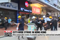 Tens of thousands of demonstrators participate in city-wide protest in Hong Kong on Monday