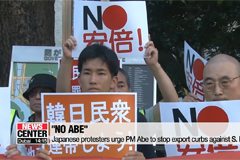 Japanese protesters urge PM Abe to stop export curbs against S. Korea