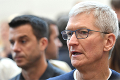 Tim Cook defends decision to r