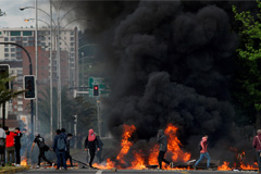 Protests in Chile leave 8 dead, with capital and 5 provinces under state of emergency
