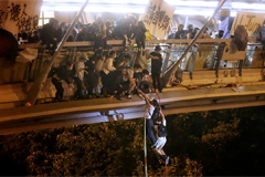 Hong Kong protesters arrested as they attempt to escape besieged university