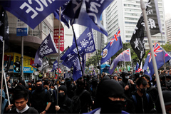 Hong Kong protestors clash with police during New Year's Day rally