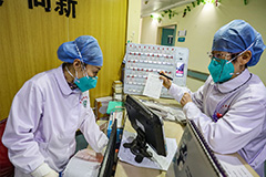 China reports at least 43 more deaths from coronavirus