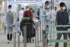 Outdoor COVID-19 testing booths at Incheon Int'l Airport screening arrivals from Europe