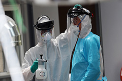 Healthcare workers battle heatwave in protective suits on Covid-19 frontlines