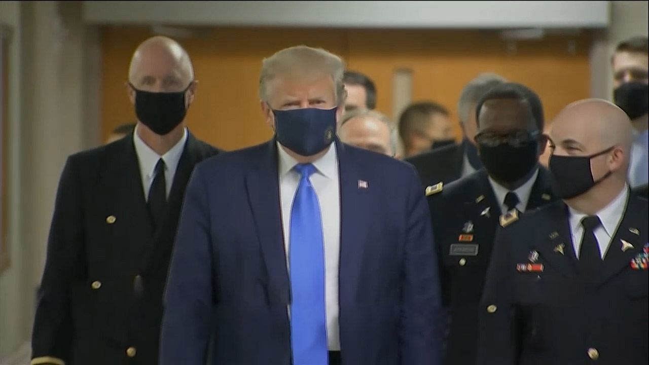 Trump finally seen wearing mask in visit to wounded soldiers