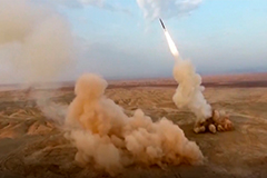 Iran fires first underground ballistic missile on last day of its military drill