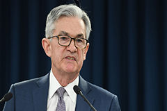 Federal Reserve keeps rates steady, citing slight pick up in economy activity