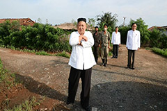 Kim Jong-un makes rare inspection at flood-damaged village
