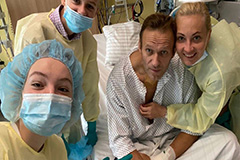 Russian critic Alexei Navalny posts hospital photo, plans to return to Russia