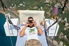 Turkish paraglider takes nap on bed while flying