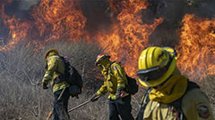 Two wildfires in southern California cause 100,000 evacuees and 2 severely injured fire fighters