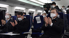 President Moon test rides S. Korea's first electric multiple unit bullet train