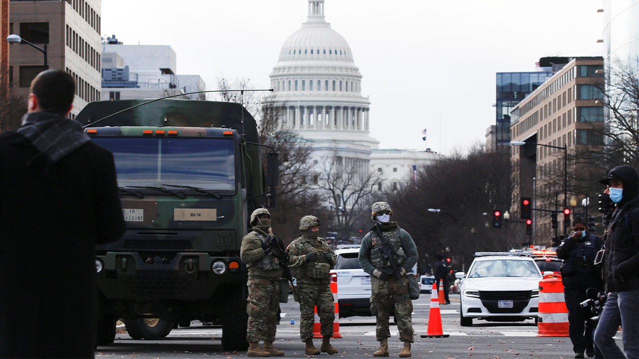 Biden's inauguration ceremony takes place amid barricaded, empty streets guarded by armed troops