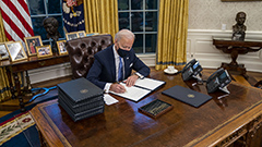 Biden signs more than dozen executive orders as he tackles COVID-19 and reverses Trump's orders