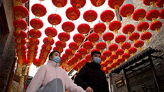 People across China celebrate upcoming Lunar New Year with light shows, performances