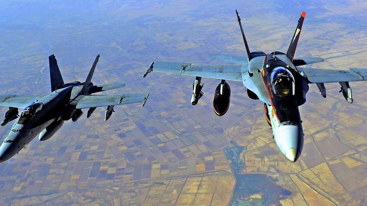 U.S. launched airstrikes in Syria, targeting facilities of Iranian-backed militia groups