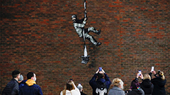 Street artist Banksy may have scaled prison wall for latest work
