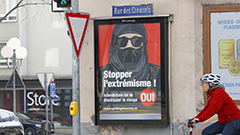 Switzerland votes to ban face coverings in public