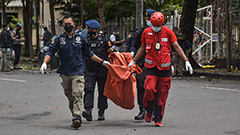 Indonesian police say church suicide bombers likely members of radical group affiliated with IS