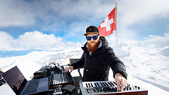 French electro artist Teho performs on mountain top in Swiss Alps