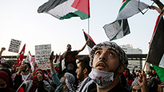 Rocket fire resumes in Gaza, Palestinians hit streets to protest