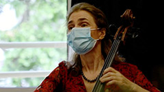 Solo cellist visits patients at end-of-life care home in Paris to ease their pain