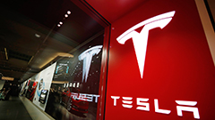 Tesla shares rise to close at all-time high