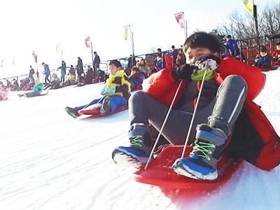 Sledding at Seoul Land