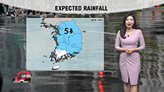 More rain across country through this afternoon, breezier temperatures