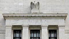 Federal Reserve holds rates at near-zero levels, continues asset purchases
